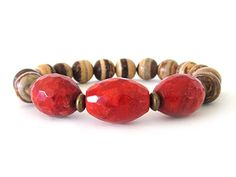 Casual and cool! This women's beaded stretch bracelet is the perfect accessory for those fun summer days featuring oval faceted coral beads, 8mm Tiger round coconut shell beads and antiqued brass accent beads.