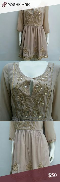 "🍁🌻Free People mini dress 🌻🍁 In pre loved excellent condition.  Size 4.  Embroidered.  Gold and silver sequins.  Lining.  Some threads are pulled  ( can be cut off ). Nothing major.  Length laying flat about 32"".  Color looks like pale pink. Quartz rose. 🔴 I DO NOT TRADE Free People Dresses Mini"