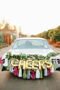 Cheers Balloons & Paper Tassels: Oh Shiny Paper Co./ Florals: Tricia of Queenpeach Designs - Holiday Glam by Kim Rico (Styling) + Megan Welker (Photography) - via Grey likes weddings