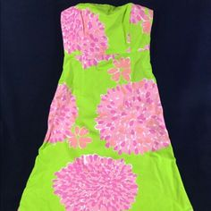 """Lilly Pulitzer Bon Bon Strapless Sabrina dress sz4 Lilly Pulitzer Bon Bon Strapless Tie Back A-Line Sabrina Dress size 4 chest measures approximately 15.5 pit to pit Waist measures approximately 14.5. Length from center of the chest (top front) measures approximately 36"""" size 4 pattern name is Bon Bon Colors are bright shows minimal if any wear.Top has rubber strip to keep it in place and front boning to keep the shape. Colors are bright with no fading Lilly Pulitzer Dresses Strapless"""