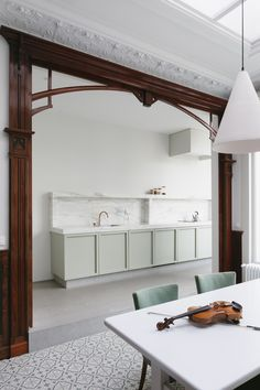 A Pale Mint Kitchen by Hans Verstuyft