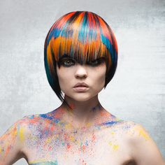 Short blunt asymmetrical haircut with some slight layering and bangs cut on a creative line.