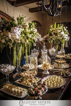Green and white floral centerpieces & dessert table | Wedding Planning & Design by Luxury Estate Weddings & Events | luxuryestateweddings.com