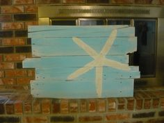 Beach and Starfish Wall Hanging Reclaimed Wood Rt. Justified. $45.00, via Etsy.