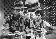 "Humphrey Bogart with a young Robert Blake in "" the treasure of the Sierra Madre"" 1948 Humphrey Bogart, Western Film, Best Western, Classic Hollywood, Old Hollywood, Bogart Movies, Bogie And Bacall, Dog Day Afternoon, Movie Of The Week"