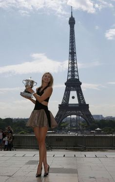 Sharapova earned this glamorous moment of lifting the prestigious Coupe Suzanne Lenglen with the Eiffel Tower in the background, wearing a wonderful Jay Ahr dress and Christian Louboutin heels. - See more at: http://www.womenstennisblog.com/2014/06/09/sharapova-captures-perfection-rg-trophy-eiffel-tower-backdrop-paris-glam-shoes-dress/#sthash.WsFMl9i7.dpuf