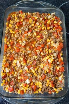 ground beef, corn and diced tomato mixture in a baking dish Recipes Using Ground Beef, Beef Recipes For Dinner, Instant Pot Dinner Recipes, Cooking Recipes, Dishes Recipes, Quick Recipes, Meat Recipes, Delicious Recipes, Crockpot Recipes