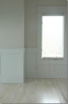 White-wash floors and wall panels are great. Love the neutral colors