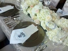 A beautiful design by Amos Gott, we really created a beautiful table scape for a rather intimate wedding reception dinner. A small space but focusing on the seating and table really made for a spectacular setting. details like custom embroidered cloth napkins upped the elegance factor.