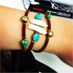 Two pearl pieces in the middle and stones, real turquoise. Love this bracelet!