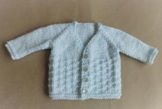 Powder Blue Baby Cardi | This is the perfect baby sweater knitting pattern for the little one in your life!