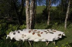 Eco Coffin – The Leafcocoon (UK) A natural soft wool eco coffin with a shroud inside.
