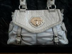 Authentic White Kathy Van Zeeland Handbag. Starting at $18 on Tophatter.com!