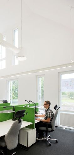 Worldwide construction giant Skanska has an attractive office for their location in Helsingborg, Sweden. The office, beyond being attractive, is incredibly energy efficient, producing enough energy to power itself through the use of photovoltaic cells.