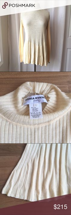"""Sonia Rykiel Paris Butter Cream Pleated Wool Top Sonia Rykiel Paris Butter Pleated Wool Knit Top Designer Sonia Rykiel Paris made in Italy with quality super soft wool. Pressed pleats give this top gorgeous detail and forgiving stretch. Marked size L measures 24"""" flat across pit to pit, 30"""" long. Ribbed long sleeves and loose funnel neck. Signature SR charm attached. Beautiful butter cream color and one of a kind stylish look! Sonia Rykiel Tops"""