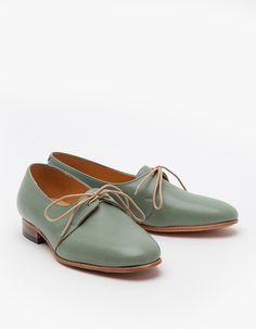 Leather round toe oxford by Dieppa Restrepo. Features leather sole and insole, low stacked heel, low cut vamp with extended tongue and lace up overlay.   100% Leather