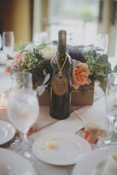 #winebottle #tablenumbers  Photography: Lime Green Photography - limegreenphotography.com