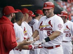 """""""Big City"""" makes his way down the line of teammates after he hit a 2 run homerun against the Reds.  Cards shutout the Reds 10-0    4-10-13"""