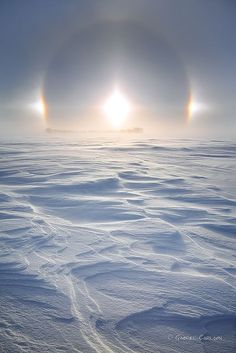 Sun Dogs ~ are made of a large family of halos, created by light interacting with ice crystals in the atmosphere. Sun Dogs are best seen and most conspicuous when the Sun is close to the horizon.