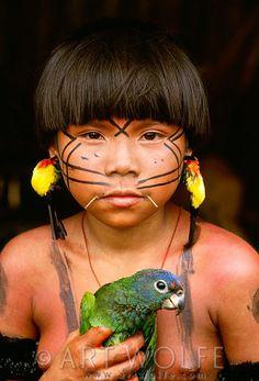 """Yanomamo girl with blue-headed parrot, Parima Tapirapeco National Park, Venezuela"""