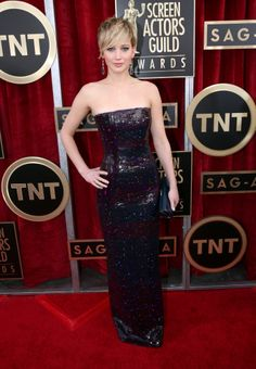 Jennifer Lawrence at the 2014 SAG Awards. This dress looked better on tv than in this pic.  The sparkles are doing something weird in this pic.