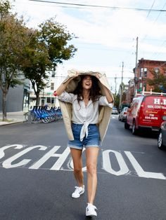 our stylist extraordinaire Lisa's denim soulmate: the high-rise denim boyshorts, worn here with the abroad trench coat.