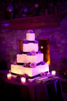 A square, twisted wedding cake with plum accents at a winery in Hammonton, NJ with Merri-Makers caterers.