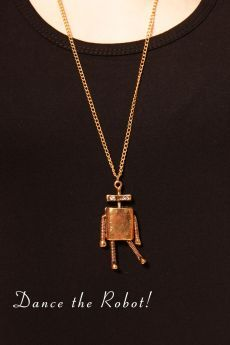 This cute robot pendant is a great addition to your party outfit!