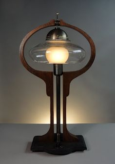 """The Donovan Harp"" Table Lamp  Influenced by the 19th century harp-styled oil lamps. Elements of Art Nouveau and Craftsman styling but gently updated."