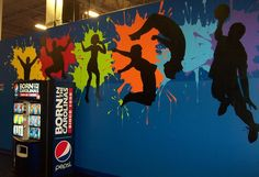 One of many murals painted in Sky High Sports Indoor Trampoline Park in Pineville, NC by Tina Sansone Vinson