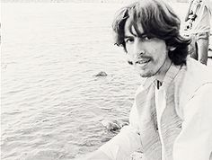 George Harrison splashes you with water for his own entertainment.