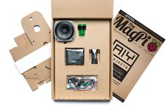 Photo of the free AIY Projects kit bundled with The MagPi 57: HAT accessory boards, wires, button and custom cardboard housing