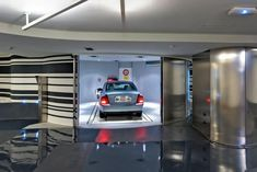 Parksafe 580 is an automatically controlled parking system with one central vertical lift and storage shelves positioned either rightwards or leftwards to the vertical lift. Storage Shelves, Car Parking, India, Management, Space, Blog, Storage Racks, Floor Space, Goa India