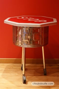 Love this cute little washing machine drum table with the stop sign top. They found the sign along the Loire river in France. #repurposed #recycled