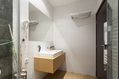 Light Wooden Wall Mounted Vanity With White Sink