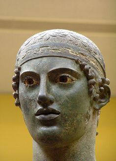 Charioteer from the Sanctuary of Apollo- Detail. Primarily bronze with copper for eyelashes and lips, silver for the headband and onyx for the eyes. ~478 or 474 BC. Gifted by Polyzalos, tyrant of Gela in Sicily. Archaeological Museum of Delphi.