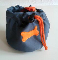Dark grey dog treat bag with a colourful bone motif by DoGATAilla