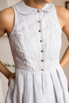 Simplicity in all its glory. Pinstriped linen dress with brass buttons and a peter pan collar. The lightweight summer dress with that vintage touch! Now available at www.victoireboutique.com