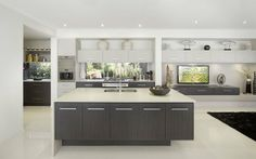 Love how the upper cabinets flow from the kitchen into the living area.