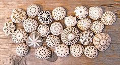 Crochet-covered river stones - as beach wedding favors