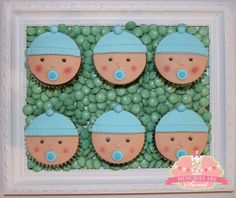 Blue Boy Baby Shower Ideas - Blue Baby cookies. Sweet baby fondant decorated cookies placed on a layer of candy.