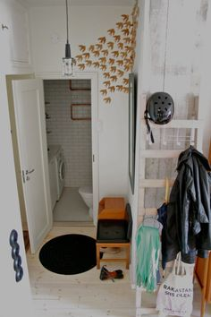 LOVE the idea of having a ladder in the entryway, adding hooks, and using it as a coat hanger.