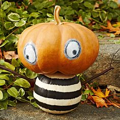 For these friendly #pumpkin people, look for small- to medium-size pumpkins that stack nicely. Paint on stripes and eyes and add twigs for arms.