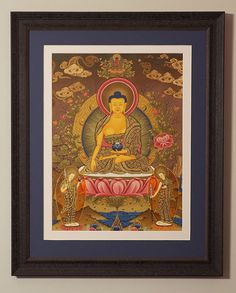 Shakyamuni Buddha with two disciples - Original Tibetan Thangka framed by Naggar Valley.  http://naggarvalley.com/product/tibetan-thangka-painting-shakyamuni-with-two-disciples-brown-orange-deep-pink-and-gold-480mm-x-355mm/