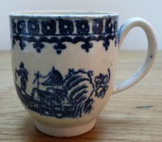 Liverpool Coffee Cup 2 Liverpool c1790 I think this is a Seth Pennington example. Decorated with the Fisherman print with border outside the rim. The cup is 64mm high with a grooved loop handle. Good condition, no damage, showing kiln spit at the outside of the rim and in the foot of the cup, £36