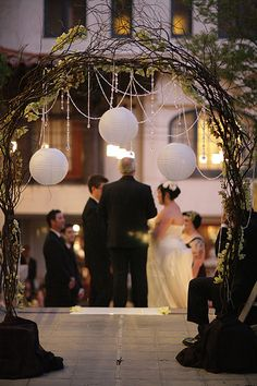 branch wedding arch - wondering if you could reproduce a less thick/elaborate version of this with the wiry fake branches they have at craft stores.