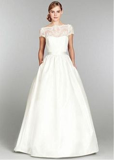 This charming dress is made of satin shaping a sweetheart neckline inside andall-over laceoutside the bodiceshaping an illustion bateauneckline, cap sleeves and a deepv-back.The skirt with a of this dress is made of taffeta and the hand tied belt is made of satin.