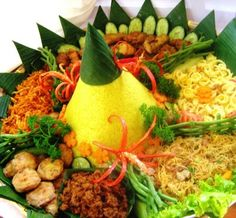 nasi tumpeng, yellow rice with many dishes. indonesian food for celebrate event