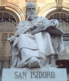 Statue of St. Isidore of Seville (c.560–636) at the entrance staircase of the National Library of Spain, in Madrid. Sculpted in Italian white marble by José Alcoverro y Amorós in 1892. St. Isidore was a philosopher, theologian and Father of the Church. He is also the patron saint of the internet, computers, computer users and computer technicians. (source)