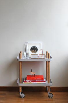 Wheeled side table Normann Copenhagen block table , Hay design candle holder , Lexon digital clock , framed illustration of Natasha Newton